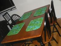 4 Seat dining table. Brown and black in color. 1 year
