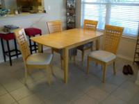 We are selling our wooden dining table / breakfast