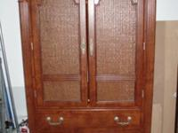 This is a great wooden armoire that would be perfect in