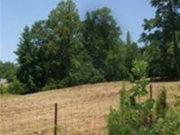 Southern Living at its finest! 15 acres including