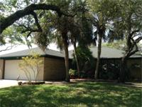 Cul-de-sac pie shaped lot boasts shade for multiple