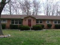 4 BR/3 full bath all brick home offers a new roof, new