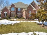 Immaculate home situated on golf course. Hardwood
