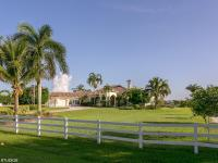 Gated custom estate home with 4br/4bths plus an