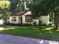 Large 4 bedroom 3 bath home on a corner lot with good