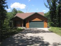 Enjoy this 4 bedroom 3 bath home snuggled in the woody