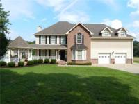 STUNNING CUSTOM BUILT HOME ON 41 ACRES W/ UPGRADES