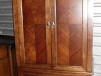 It is by Lane Furniture, has nice molding at the top, 2