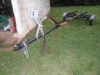 Old design flat bottom or V-bottom boat trailer in