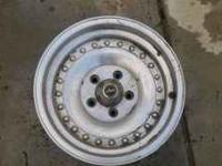 I have a pair of brushed aluminum wheels 15x7 with a 5