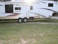 You are looking at a 2009 Keystone Laredo 5th Wheel, it