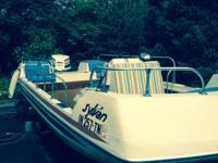 16 foot deck boat and 100hp outboard motor. New marine