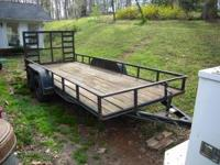2002 model trailer. 16 foot with fold down ramp.