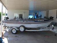 16 ft Sylvan Pro Fisherman with 50 HP Mercury engine in
