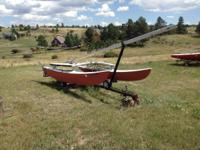 I have a 16ft Hobie Cat with Trailer. The sails were
