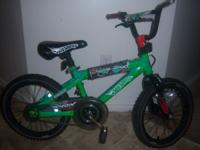 "Selling a used 16"" Hot Wheels kids bike for only"