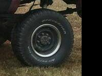 Stock steel gm 8 bolt rims painted black with chrome