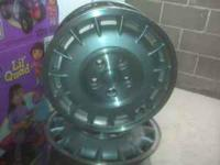 4 Stock Buick rims in good condition. 1 rim with tire.