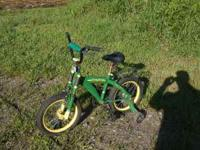 "16"" John deere Bike hardley ridin. $25. paid $100"