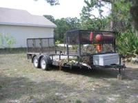 16' LAWN TRAILER IN GREAT SHAPE. IT HAS WEED EATER