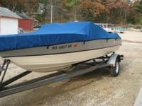 This is a 1986 Monark ski boat with a 1994 Mariner 90hp
