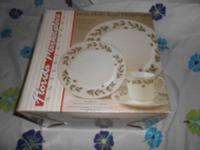 I have (2) 16 Piece Christmas Holly Berry Dinnerware