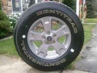 "16"" alloy rim and New Continential Contitrac tire ("