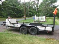 16'0 x 6'5 trailer, wood deck, adjustible ramps, new
