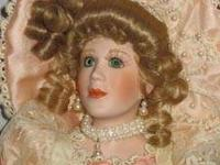 Madame Marguerite is a porcelain doll from the Franklin