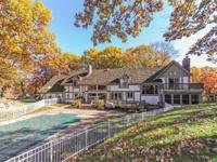 Stunning 3 acre Tudor estate on private, wooded, cul de