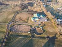 A Horse lovers paradise! This 34 acre Grand Equestrian