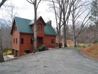 PARK-LIKE APPEAL! Exceptionally Gracious Log Home