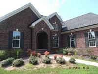 This brick home is amazing.  It sits on 5.05 acres of