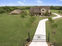 Gated & private, this 7.66 ac home offers a main house