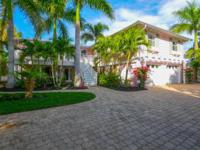 This beautiful Key West style home is a close walk to