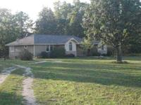 Ranch style home with walkout basement on 6 acres.