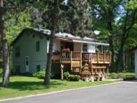 Country home with 2 large garages on 9.76 acres north