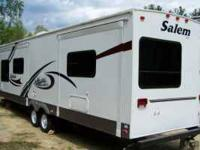 *13-Inch TV *2 Slide Outs *20-Inch TV *21 Ft. Awning