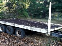 Heavy duty, triple axle trailer. Painted diamond plate