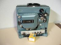Eiki Model RT0 w/ reels and spare belt. Uses 200 watt