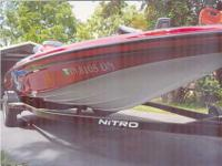 2006 NITRO 482 dual console, red metal flake w/some