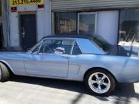 I am selling a classic 1965 blue Ford Mustang it is in