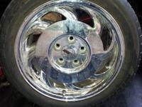 "A set of original equipment chrome 17"" Corvette wheels."