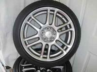 These are 17 inch Silver Enkei Wheels with Tires. They