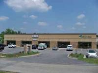 New Retail Center (Brick and Stucco) with (1) 1,877 SF