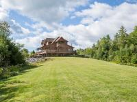 Robinson Hill is a spectacular combination of Log Home