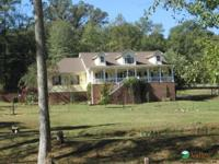 "Mini Farm"" on 3.79 acres with stocked pond and fenced"