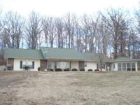 Beautiful berm home located on a fenced in m/l 5 acres.