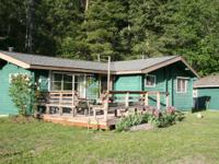 Cozy cedar cabin retreat with horse corral.  Two