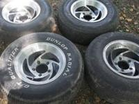 "Four five lug 15"" tires and wheels. The tires don't"